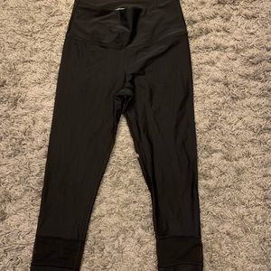 Cropped workout pants with mesh inserts